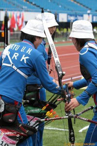 Photo of North Korean women's recurve team at the Shanghai World Cup 2014 by Dean Alberga